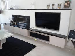 narrow long floating media cabinet with door and shelf plus wall