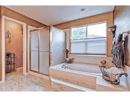 on suite master bathroom with tub stand up shower double sinks