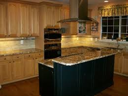 black island kitchen medium oak cabinets with a black island search for the