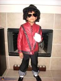 boy dressed as michael jackson in thriller costume works