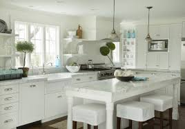 small kitchen white cupboards counter stools white shaker