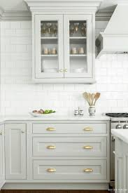 best 25 light kitchen cabinets ideas on pinterest light gray look we love gray kitchen cabinets with brass hardware