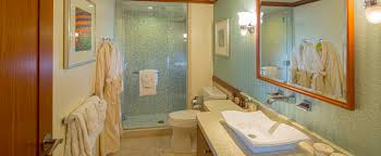 one bedroom deluxe suite aulani hawaii resort spa the bathroom in a deluxe 1 bedroom suite includes tile walls stone countertops and