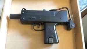 kitchen gun two men jailed after semi automatic submachine gun found in