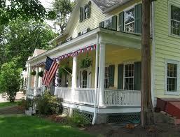 wrap around porch colonial home design ideas