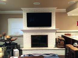 fireplace cleanly tv above fireplace for inspirations tv