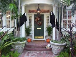 Halloween Decorating Doors Ideas Simple But Very Scary With 2 Ghost Decoration In Black In Front Of