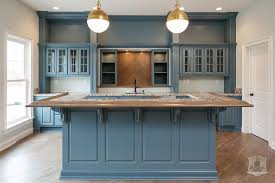 blue kitchen backsplash blue kitchen with wood herringbone tile backsplash contemporary