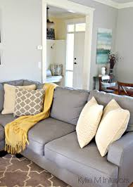 how to make a gray paint colour feel warm shown in living room