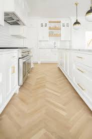 white shaker kitchen cabinets wood floors design trend herringbone wood floors the house