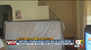 furniture delivery warning woman stuck with bed in living room