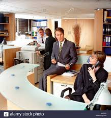 Modern Office Reception Desk by Modern Office With Reception Desk Staff Chatting In A Relaxed