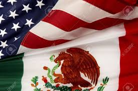Mexican Flag Eagle Close Up Shot Of The Mexican And American Flags Stock Photo