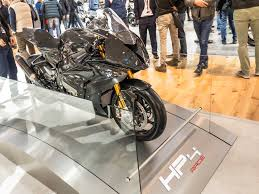 milan show say hello to the carbon framed bmw hp4 race mcn
