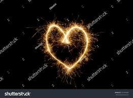 heart sparklers heart sparklers on black backgroundlove light stock photo