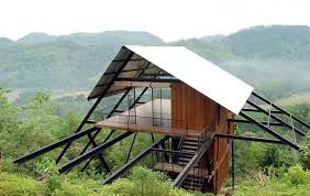 wooden house idea on mountainous area with thick wood