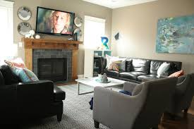 gray rectangle tile fireplace frame plus brown wooden shelf and tv