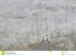 old white and grey painted concrete wall with weatherstains stock