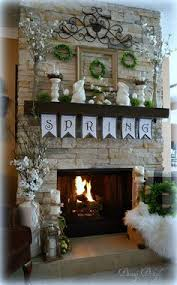 fireplace decor ideas a few key pieces like the glass jars and driftwood decor from