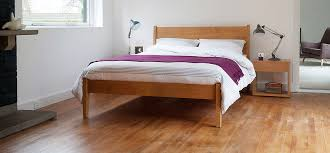 the solid oak bed with a slightly u0027mid century modern u0027 feel the
