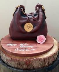 louis vuitton purse cake accented with edible money jewelry and