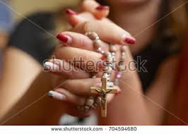 praying rosary stock photo 704594686
