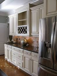 White Kitchen Cabinets With Glaze by Off White Cabinets With Brown Glaze Antique White Off White