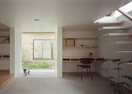 minimal extension adds chic usable space to japanese home