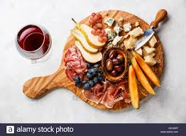 cheese plate meat and cheese plate antipasti snack with prosciutto ham