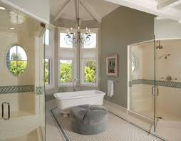 Beige Walls White Trim by Bathroom Beige Tile Floor Glass Door Gray Ottoman Floor Clawfoot