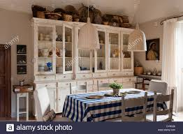 rustic country kitchen with french style cabinets checked blue