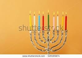 hanukkah candles colors menorah candles hanukkah on color background stock photo 520185874