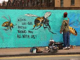 a london street artist paints swarms of bees on urban walls to bees 8