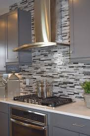 this beautiful backsplash adds dimension to the kitchen and helps