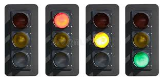 signs traffic light with yellow and green lights stock image