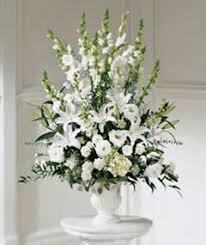 funeral arrangement what flowers do you think of for funerals memorials