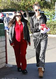 pregnant kourtney kardashian shows off her bump in red onesie as