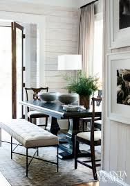 and chairs are simply perfect in this rustic coastal dining room