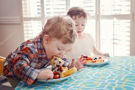 Kids Eating Table Two Happy Kids Twins Boy Eating Breakfast Waffles With Fruits
