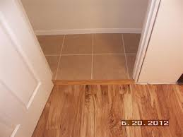 Laminate Flooring Transition Pieces Our Projects Basement Finish Boat Room Flooring