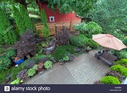 backyard garden landscaping with paver bricks patio hardscape
