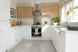 white kitchen cabinets grey floor use light shades for a bright