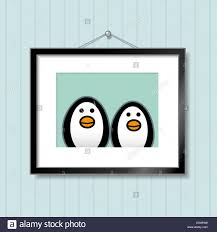 cute portrait of penguin couple in picture frame hanging on blue