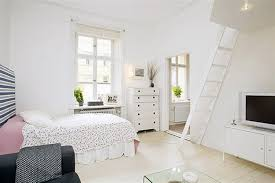 swedish minimalist bedroom idea with floral bedding and small