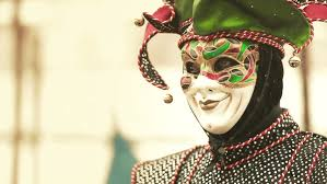 venetian jester costume venice italy circa 2013 using a jester costume poses for