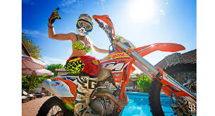 motocross bike pictures wearing stilettos on a dirt bike shows how badass russian riders