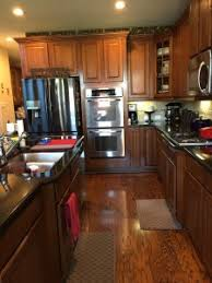 are brown kitchen cabinets outdated a kitchen goes from and dated to bright and airy