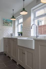 sinks cottage kitchen style blue cabinets white porcelain tile in
