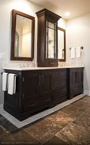 double sink vanity with middle tower i like the medicine cabinet between the two sinks in this bathroom
