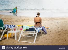 Chairs On A Beach A Tanned Tatooed Woman Sits On A Beach Chair On St Croix U S